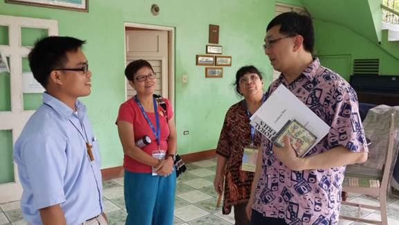 Lim Swee Hong of Singapore (right) speaks with Brother Richie at the head office for Missionaries of the Poor.  The music ministry of Father HoLung, founder, of Missionaries of the Poor,  provides financial support for their work with the disabled, homeless and elderly. Rev. Dr. Yak Hwee Tan (2nd from right) and Simei Montiero of Brazil (3rd from right) share in the discussion