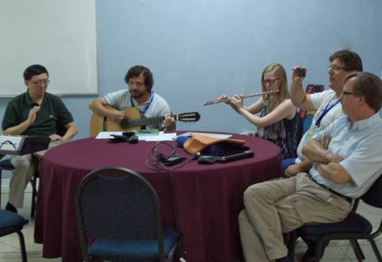 Making beautiful music. Participants in the workshop combine their skills to create worship material
