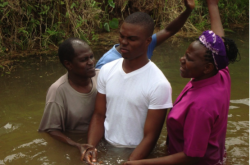 Elizabeth and William Chirwa participate in baptism by immersion.